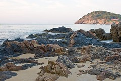 beach, sand, sea, ocean, bay, tide pool, body of water, formation, geology, shore, terrain, coast, rock, cliff,