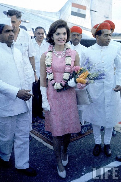 First Lady Jacqueline Kennedy being met by the Maharaj of Mewer (l) on her arrival.
