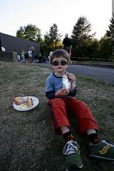 nick having a hot dog at his elementary school bbq  …