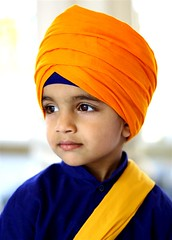 orange, face, dastar, clothing, yellow, turban, headgear,