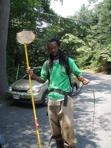 Image of a DEP biologist with electrofishing equipment.