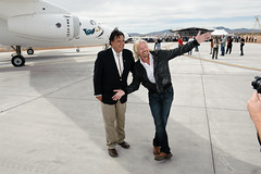 Sir Richard Branson jokes with Governor Richardson in the excitement of the first spaceship landing at Spaceport America. Photo by Jeffrey Vock