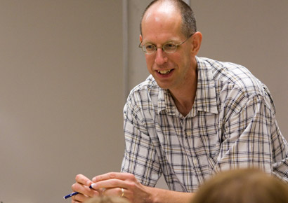 Newman University professor, Kelly McFall, leading a discussion in class