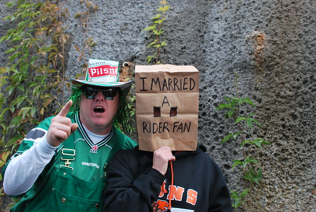 Saskatchewan Roughrider fan - and his wife by CC user kneoh on Flickr