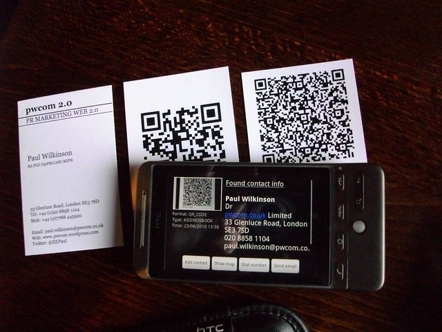 QR code on smart phone and paper