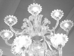 clothing(0.0), headpiece(0.0), petal(0.0), light fixture(1.0), white(1.0), monochrome photography(1.0), chandelier(1.0), monochrome(1.0), black-and-white(1.0), lighting(1.0),
