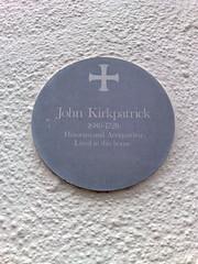 Photo of John Kirkpatrick grey plaque