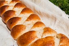 baguette(0.0), baking(1.0), tsoureki(1.0), bread(1.0), baked goods(1.0), ciabatta(1.0), challah(1.0), food(1.0), bread roll(1.0),