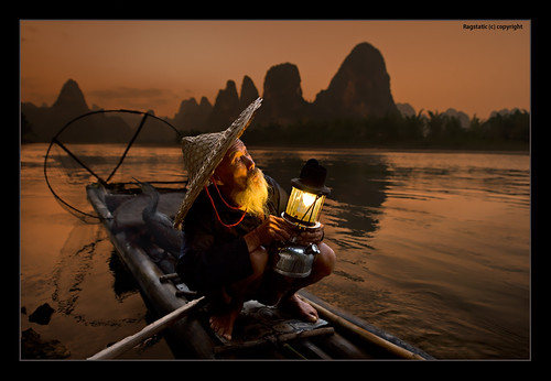 world life china old travel light shadow people mountain fish man color bird heritage nature water hat river beard relax landscape flow liriver still fishing fisherman nikon exposure view dusk earth stones guilin rags quality culture scene cormorant raft lantern ng shallow karst publication peasant nationalgeographic subtle travelogue guangxi lifescape xingping d700