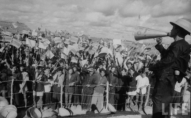 1956 - Crowds cheering Ngo Dinh Diem along route, during visit.