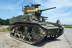 armored car(0.0), army(0.0), churchill tank(0.0), combat vehicle(1.0), military vehicle(1.0), weapon(1.0), vehicle(1.0), tank(1.0), self-propelled artillery(1.0), gun turret(1.0), land vehicle(1.0), military(1.0),