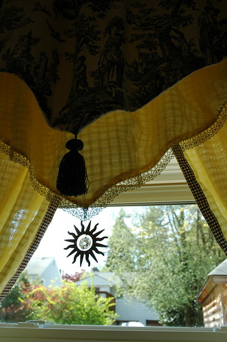 Toile drapes with sun crystal, and blue and cream border, handmade yellow curtains, kitchen, Seattle, Washington by Wonderlane