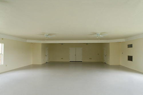 Large empty white room, VFW Hall, rural Leander, Texas. Architecture of empty space