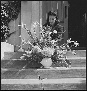 Oakland, California. Arranging flowers for alter on last day of service at Japanese Independent Con . . ., 04/26/1942