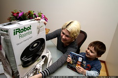 rachel unwrapping a roomba
