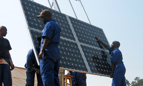 Training workers to install solar panels at health clinics in Rwanda provides clean energy, creates jobs, and improves health service delivery.