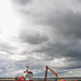 Small photo of Amble Harbour with Dredger