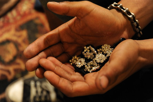 Hands full of jewelry, chain bracelet, Wedgwood, Seattle, Washington, USA by Wonderlane