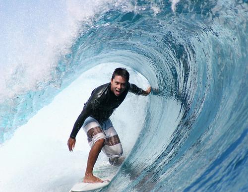 Pro-surfer Dennis Tihara surfing a tube at Teahupoo, Tahiti.