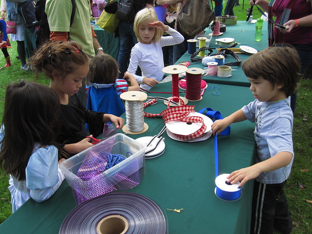 Visitors work on the Worldwide (Spider) Web at Ghouls and Gourds 2010. Photo by Rebecca Bullene.