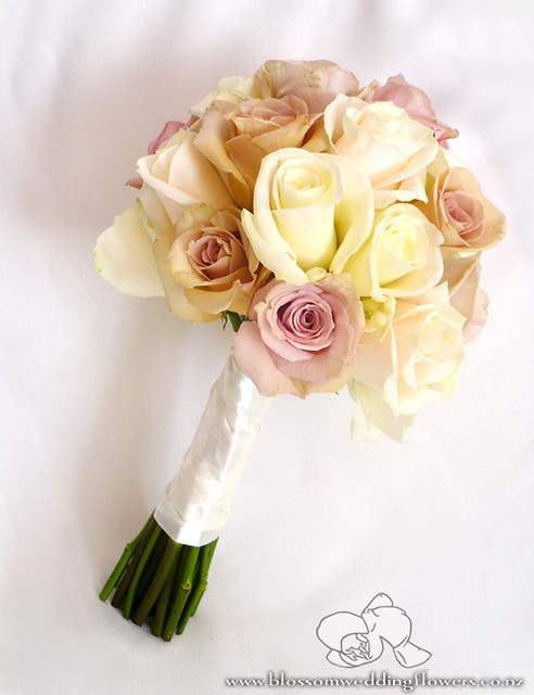 Bridesmaids bouquet of ivory champagne and coffeepink open roses