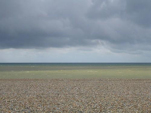 Sea, shingle, and sky.
