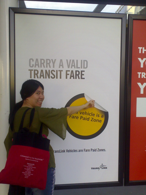 Karen Peels Off the Fare Paid Zone Sticker at Brentwood Station