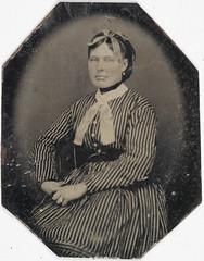 Woman in striped dress, ca. 1856-1900.