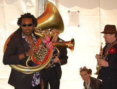 string instrument(0.0), tuba(0.0), singing(0.0), sousaphone(1.0), musician(1.0), musical instrument(1.0), music(1.0), brass instrument(1.0), performance(1.0),