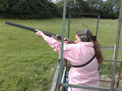 archery(0.0), target archery(0.0), bow and arrow(0.0), weapon(1.0), shooting(1.0), clay pigeon shooting(1.0), sports(1.0), recreation(1.0), outdoor recreation(1.0), trap shooting(1.0), skeet shooting(1.0),