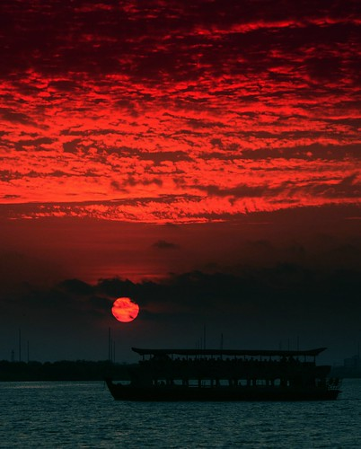 sunset silhouette clouds boat