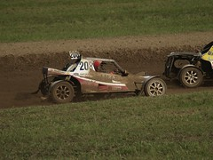 sprint car racing(0.0), auto racing(1.0), automobile(1.0), racing(1.0), vehicle(1.0), stock car racing(1.0), sports(1.0), race(1.0), dirt track racing(1.0), off road racing(1.0), motorsport(1.0), off-roading(1.0), race track(1.0), mud(1.0), sports car(1.0),