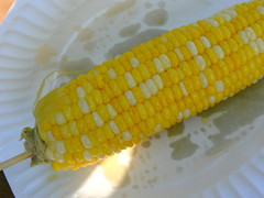 produce(0.0), fruit(0.0), dish(0.0), sweet corn(1.0), yellow(1.0), maize(1.0), corn on the cob(1.0), food(1.0), cuisine(1.0),