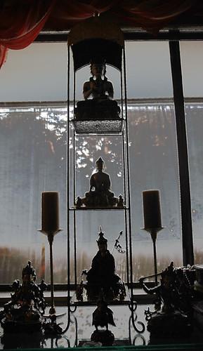 personal shrine, Vajrasattva, Lord Buddha, Padmasambhava, Arya Tara, Manjushri, Vajra Garuda, and candles by Wonderlane
