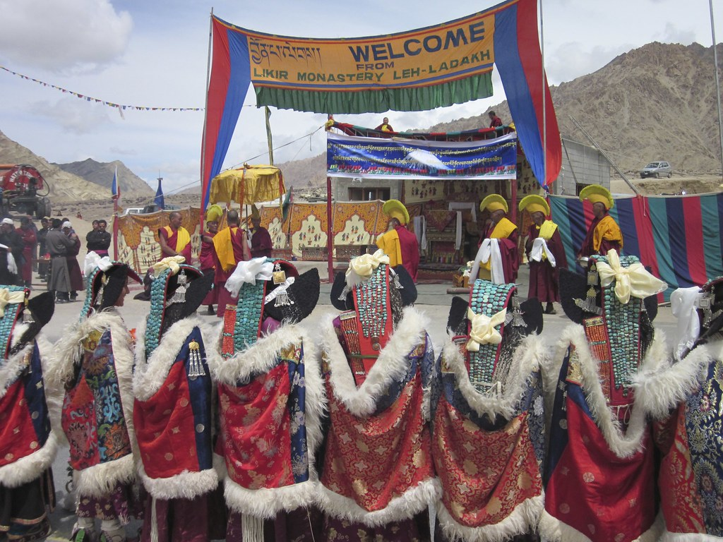 Monastery sign welcoming Lama at religious festival, India