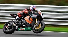 supermoto(0.0), stunt performer(0.0), automobile(1.0), superbike racing(1.0), grand prix motorcycle racing(1.0), racing(1.0), vehicle(1.0), sports(1.0), race(1.0), motorcycle(1.0), motorsport(1.0), motorcycle racing(1.0), road racing(1.0), motorcycling(1.0), race track(1.0), land vehicle(1.0), isle of man tt(1.0),