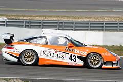 porsche 911 gt2(0.0), ruf ctr(0.0), convertible(0.0), auto racing(1.0), automobile(1.0), racing(1.0), porsche 911 gt3(1.0), wheel(1.0), vehicle(1.0), performance car(1.0), automotive design(1.0), porsche(1.0), motorsport(1.0), race track(1.0), land vehicle(1.0), luxury vehicle(1.0), supercar(1.0), sports car(1.0),