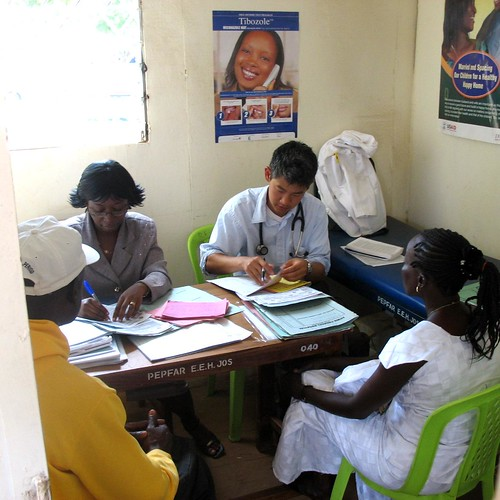 Two doctors seeing two patients in PEPFAR clinic