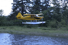 watercraft rowing(0.0), boating(0.0), boat(0.0), aviation(1.0), airplane(1.0), vehicle(1.0), seaplane(1.0),
