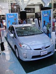 sports car(0.0), automobile(1.0), automotive exterior(1.0), toyota(1.0), wheel(1.0), vehicle(1.0), automotive design(1.0), auto show(1.0), bumper(1.0), toyota prius(1.0), land vehicle(1.0),