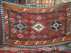bed sheet(0.0), flooring(0.0), tapestry(1.0), art(1.0), pattern(1.0), textile(1.0), prayer rug(1.0),