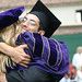 Student and Professor sharing a hug and congradulations