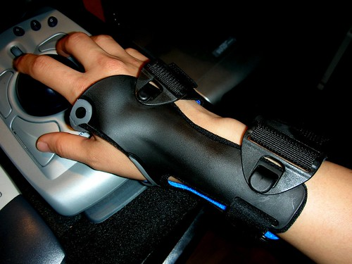 A person wearing a wrist brace while gaming.