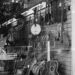 Mandolin-Banjo, Ukes, Tambura, Guitars & The Neck Of A Lute In The Window Of Luthier's Co-Op (Easthampton, MA)