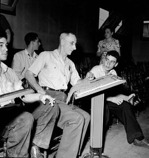 Workmen of the Polymer Corporation Limited plant enjoy a game of bowling in the plant bowling alleys. / Des ouvriers de la Société Polymer Limitée s'amusent dans le salle de quilles de l'usine