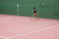 floor(0.0), soft tennis(0.0), tennis court(0.0), tennis(0.0), baseball field(0.0), tennis player(0.0), wall & ball sports(1.0), sport venue(1.0), sports(1.0), ball game(1.0), racquet sport(1.0),