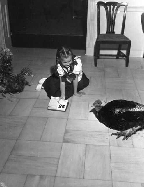 Governor Collins' daughter Darby with Thanksgiving turkey at mansion: Tallahassee, Florida