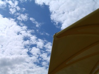 Image de HTO Beach. sky toronto clouds umbrella hto