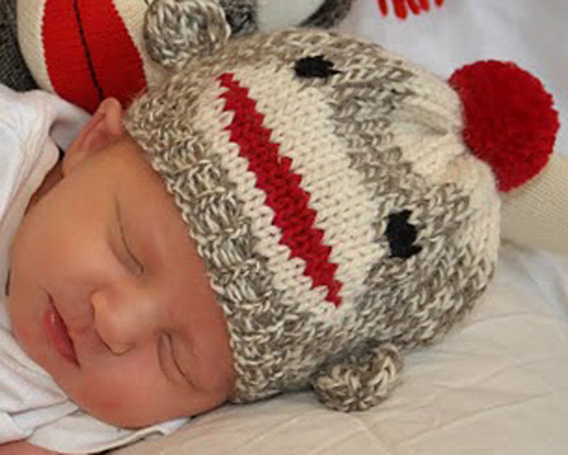 Sock Monkey Hat Knitting Pattern : knitted sock monkey hat for a newborn baby Flickr - Photo Sharing!