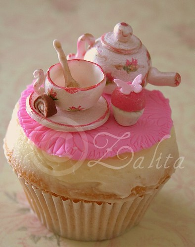 vintage tea set with cupcake